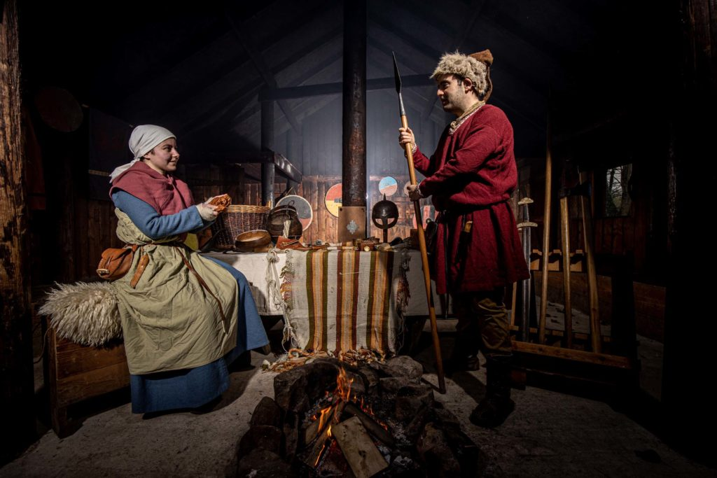 Viking Woman and Man in a Viking home with Viking artefacts all around Murton Park